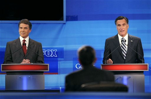 "<div class=""meta ""><span class=""caption-text "">Republican presidential candidate former Massachusetts Gov. Mitt Romney, right, makes a comment as Texas Gov. Rick Perry, left, listens during a Fox News/Google debate Thursday, Sept. 22, 2011, in Orlando, Fla. (AP Photo/Phelan M. Ebenhack, Pool) (AP Photo/ Phelan M. Ebenhack)</span></div>"