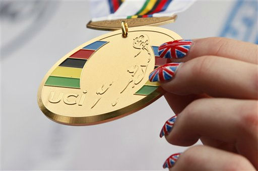 New world champion Lucy Garner of Britain, the union jack painted on her nails, holds the gold medal on the podium after winning the junior women road race over 70 kilometers &#40;43.5 miles&#41; with start and finish in Holte, north of Copenhagen, Denmark, Friday Sept. 23, 2011. &#40;AP Photo&#47;Peter Dejong&#41; <span class=meta>(AP Photo&#47; PETER DEJONG)</span>