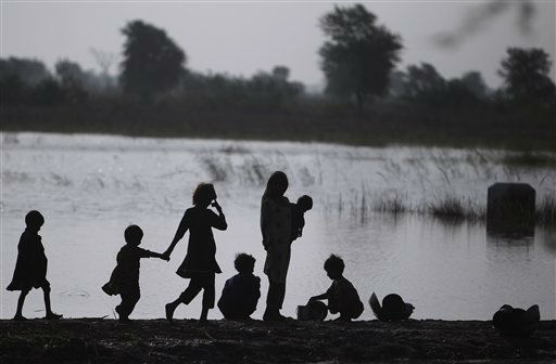 "<div class=""meta ""><span class=""caption-text "">Displaced Pakistanis wash their belongings in a flooded field in Mirpur Khas in Pakistan's Sindh province, after fleeing their flood-hit homes, Friday, Sept. 23, 2011. In Pakistan's Sindh province alone, the floods have killed over 220 people, damaged or destroyed some 665,000 homes and displaced more than 1.8 million people, according to the United Nations. Neighboring Baluchistan province has also been affected. (AP Photo/Muhammed Muheisen) (AP Photo/ Muhammed Muheisen)</span></div>"