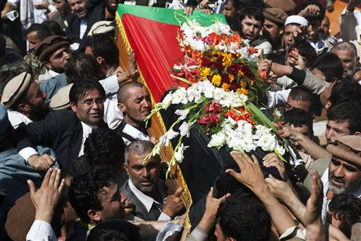 "<div class=""meta ""><span class=""caption-text "">Afghans carry the coffin of Burhanuddin Rabbani, former Afghan president and head of the government's peace council, during his burial ceremony on Wazir Akbar Khan hill in Kabul, Afghanistan, Friday, Sept. 23, 2011. Weeping Afghans gathered under tight security on Friday to bury former Rabbani, who was killed this week by a suicide bomber posing as a Taliban envoy with a message about possible talks. (AP Photo/Ahmad Masood, Pool) (AP Photo/ Ahmad Masood)</span></div>"