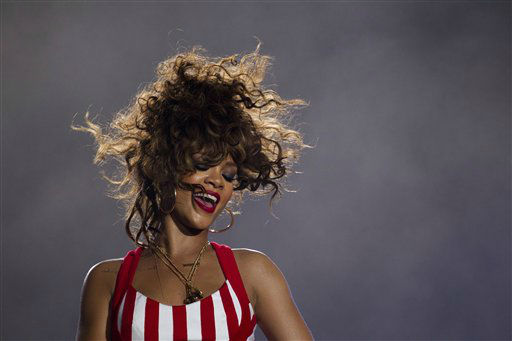 "<div class=""meta image-caption""><div class=""origin-logo origin-image ""><span></span></div><span class=""caption-text"">Rihanna performs during the Rock in Rio music festival in Rio de Janeiro, Brazil, early Saturday Sept. 24, 2011. The festival, which runs through Oct. 2, includes performances by Katy Perry, Rihanna, Stevie Wonder, Red Hot Chili Peppers, Metallica, Guns N' Roses and Coldplay. (AP Photo/Felipe Dana) (AP Photo/ Felipe Dana)</span></div>"