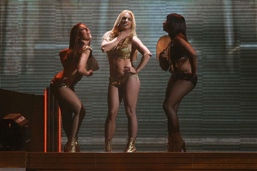 Britney Spears, center, performs on a stage during a concert  in Moscow, Russia, Saturday, Sept. 24, 2011. Britney Spears performs in Moscow, St.Petersburg and Kiev as part of her European Femme Fatale Tour. &#40;AP Photo&#41; <span class=meta>(Photo&#47;Sergey Savostyanov)</span>