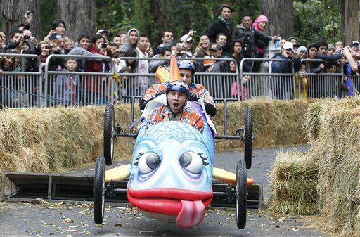 A contestant gestures as he drives his homemade vehicle during the Balineras Race in Bogota, Colombia, Sunday, Sept. 25, 2011. About 64 teams participated in the race in which  vehicles can only use human force and not any kind of fuel or engines for propulsion. &#40;AP Photo&#47;Fernando Vergara&#41; <span class=meta>(AP Photo&#47; Fernando Vergara)</span>
