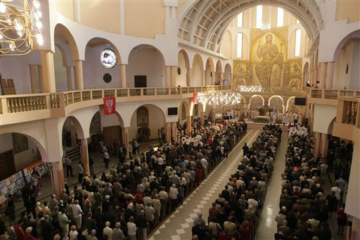 "<div class=""meta ""><span class=""caption-text "">Roman Catholic faithful join Polish politicians for a special Mass for the unity of the European Union and the success of Poland's EU presidency, in Warsaw, Poland, Sunday, Sept. 25, 2011. (AP Photo/Czarek Sokolowski) (AP Photo/ Czarek Sokolowski)</span></div>"