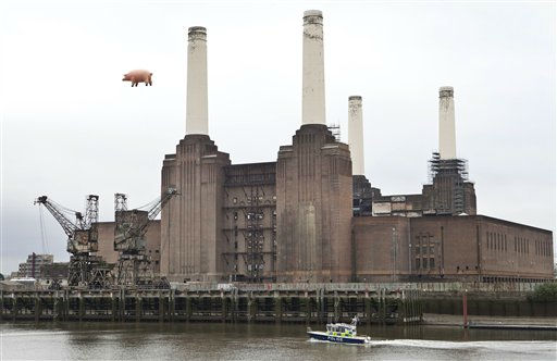 A police boat is seen on the Thames river below an inflatable pink pig, which was made famous on the sleeve of the 1976 Pink Floyd album &#39;Animals&#39;, and flies once again over Battersea Power Station in south west London, Monday, Sept. 26, 2011, 35 years later, to announce the launch of the reissue and collector&#39;s edition of &#34;Why Pink Floyd....?&#34;. &#40;AP Photo&#47;Joel Ryan&#41; <span class=meta>(AP Photo&#47; Joel Ryan)</span>