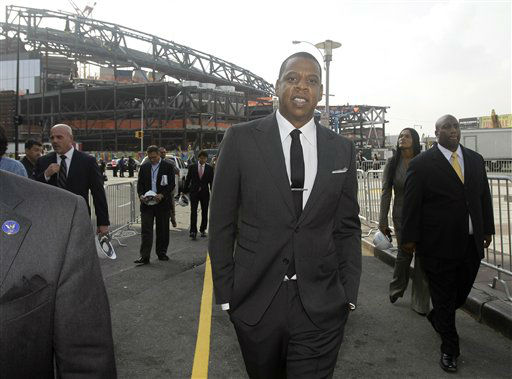Nets part-owner Jay-Z strolls down a closed-off street with the still under-construction Barclay&#39;s Center behind him, in the Brooklyn borough of New York, Monday, Sept. 26, 2011.  The hip-hop mogul said at a news conference that he will perform &#34;one, two, maybe three&#34; times at the Barclays Center. Dates haven&#39;t been set. Jay-Z also made it official that the club will be called the Brooklyn Nets. &#40;AP Photo&#47;Kathy Willens&#41; <span class=meta>(AP Photo&#47; Kathy Willens)</span>