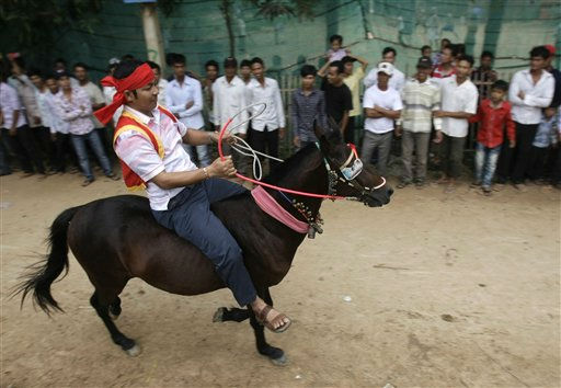 "<div class=""meta ""><span class=""caption-text "">A Cambodian man rides on a horse at Preah Vihear Sour pagoda during a water buffalo racing on Tuesday, Sept. 27, 2011, in Kandal province, some 40 kilometers (25 miles) northeast of Phnom Penh, Cambodia. Residents of the village on Tuesday held an annual water buffalo race to mark the end of a traditional celebration known as the Festival for the Dead in Cambodia. (AP Photo/Heng Sinith) (AP Photo/ Heng Sinith)</span></div>"
