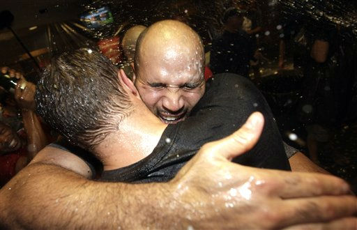 St. Louis Cardinals&#39; Albert Pujols, right, celebrates after the Cardinals clinched the National League wild card for baseball&#39;s playoffs, Wednesday, Sept. 28, 2011, in Houston. &#40;AP Photo&#47;David J. Phillip&#41; <span class=meta>(AP Photo&#47; David J. Phillip)</span>