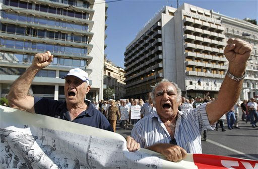 Pensioners chant slogans during an anti- austerity protest on Wednesday, Sept. 28, 2011. Another 24-hour public transport strike has left commuters in the Greek capital struggling to make their way to work as unions lash out against austerity measures the government hopes will win it approval for the disbursement of crucial bailout loans. &#40;AP Photo&#47;Petros Giannakouris&#41; <span class=meta>(AP Photo&#47; Petros Giannakouris)</span>