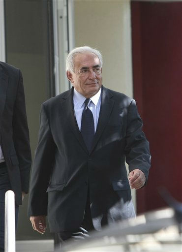 "<div class=""meta ""><span class=""caption-text "">Former IMF chief Dominique Strauss-Kahn leaves a police station after a one-on-one meeting with writer, Tristane Banon, who accuses him of attempted rape, in Paris, France, Thursday, Sept. 29, 2011.  Dominique Strauss-Kahn met in a face-to-face confrontation Thursday with a Frenchwoman who says he tried to rape her, as the two were questioned jointly by investigators deciding whether to pursue the case. (AP Photo/Mathieu Cugnot) (AP Photo/ Mathieu Cugnot)</span></div>"
