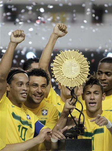 Brazil&#39;s players Ronaldinho, left, Fred, second from left, and Neymar, right, celebrate after defeating Argentina in a soccer friendly match in Belem, Brazil, Wednesday, Sept. 28, 2011. Brazil won 2-0. &#40;AP Photo&#47;Andre Penner&#41; <span class=meta>(AP Photo&#47; Andre Penner)</span>