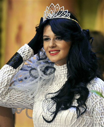 "<div class=""meta ""><span class=""caption-text "">Vesna Jakimovska smiles after being crowned Miss Macedonia 2011 during a beauty contest in Skopje, Macedonia, late Wednesday, Sept. 28, 2011. Jakimovska, 20, will represent Macedonia at the Miss World contest in London in November. (AP Photo/Boris Grdanoski) (AP Photo/ Boris Grdanoski)</span></div>"
