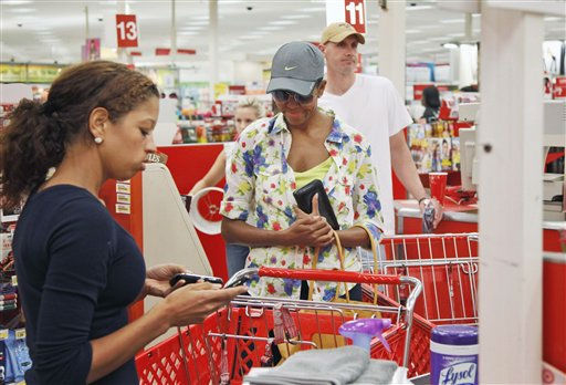 "<div class=""meta ""><span class=""caption-text "">First lady Michelle Obama, wearing a hat and sunglasses, center, stands in line at a Target Department store in Alexandria, Va., Thursday, Sept. 29, 2011, after doing some shopping. (AP Photo/Charles Dharapak) (AP Photo/ Charles Dharapak)</span></div>"