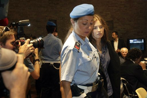 Amanda Knox walks by media representatives as she arrives at the Perugia court for an appeal hearing, in Perugia, central Italy, Friday, Sept. 30, 2011. Knox, an American student was convicted of sexually assaulting and murdering Meredith Kercher, her British roommate in Perugia, and sentenced to 26 years in prison. Knox&#39;s boyfriend at the time of the 2007 murder, Raffaele Sollecito of Italy, was convicted of the same charges and sentenced to 25 years. Both deny wrongdoing and have appealed the December 2009 verdict. &#40;AP Photo&#47;Pier Paolo Cito&#41; <span class=meta>(AP Photo&#47; Pier Paolo Cito)</span>