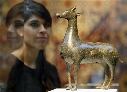 A Christie&#39;s employee looks towards an 8th century Umayyad sculpture of a deer in bronze, from Iran during a preview for the Islamic Discoveries auction, in London, Friday, Sept. 30, 2011. The sculpture is estimated at 2-3 million pounds &#40;3.12- 4.68 million US Dollars&#41; and will be auctioned in London on Oct. 6. &#40;AP Photo&#47;Kirsty Wigglesworth&#41; <span class=meta>(AP Photo&#47; Kirsty Wigglesworth)</span>