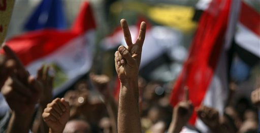 An Egyptian demonstrator flashes the V-victory sign as he attends a protest at Tahrir Square in Cairo, Egypt, Friday, Sept. 30, 2011. Several thousand Egyptians are protesting against the country&#39;s military ruler&#39;s decision to retain the much hated emergency laws used throughout the reign of ousted President Hosni Mubarak to give police almost unquestionable powers to operate. &#40;AP Photo&#47;Khalil Hamra&#41; <span class=meta>(AP Photo&#47; Khalil Hamra)</span>