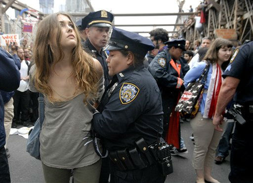 "<div class=""meta image-caption""><div class=""origin-logo origin-image ""><span></span></div><span class=""caption-text"">In this Oct. 1, 2011 photo, police arrest a protester on New York's Brooklyn Bridge during Saturday's march by Occupy Wall Street. Protesters speaking out against corporate greed and other grievances attempted to walk over the bridge from Manhattan, resulting in the arrest of more than 700 during a tense confrontation with police. The majority of those arrested were given citations for disorderly conduct and were released, police said. (AP Photo/Stephanie Keith) (AP Photo/ Stephanie Keith)</span></div>"