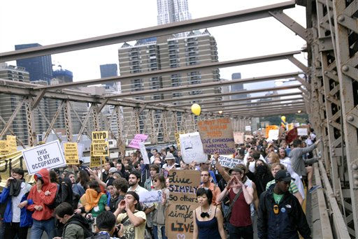In this Oct. 1, 2011 photo, protesters walk onto New York&#39;s Brooklyn Bridge before police began making arrests during Saturday&#39;s march by Occupy Wall Street. Protesters speaking out against corporate greed and other grievances attempted to walk over the bridge from Manhattan, resulting in the arrest of more than 700 during a tense confrontation with police. The majority of those arrested were given citations for disorderly conduct and were released, police said. &#40;AP Photo&#47;Stephanie Keith&#41; <span class=meta>(AP Photo&#47; Stephanie Keith)</span>