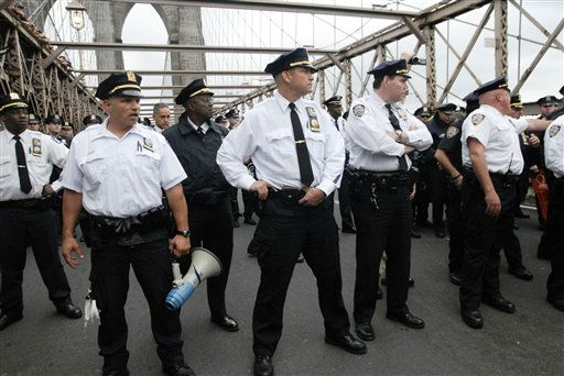 In this Oct. 1, 2011 photo, police turn to face the front line of protesters who walked behind them about one third of the way onto New York&#39;s Brooklyn Bridge before police began making arrests during Saturday&#39;s march by Occupy Wall Street. Protesters speaking out against corporate greed and other grievances attempted to walk over the bridge from Manhattan, resulting in the arrest of more than 700 during a tense confrontation with police. The majority of those arrested were given citations for disorderly conduct and were released, police said. &#40;AP Photo&#47;Stephanie Keith&#41; <span class=meta>(AP Photo&#47; Stephanie Keith)</span>