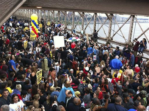 A large group of protesters affiliated with the Occupy Wall Street movement attempt to cross the Brooklyn Bridge, effectively shutting parts of it down, Saturday, Oct. 1, 2011 in New York. Police arrested dozens while trying to clear the road and reopen for traffic.&#40;AP Photo&#47;Rose Bookbinder&#41; <span class=meta>(AP Photo&#47; Rose Bookbinder)</span>