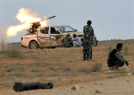 Libyan revolutionary fighters launch a missile during an attack on the city of Sirte, Libya, Saturday, Oct. 1, 2011. Rebel forces are battling to make headway against loyalist fighters inside the home town of Libya&#39;s ousted leader Moammar Gadhafi. &#40;AP Photo&#47;Bela Szandelszky&#41; <span class=meta>(AP Photo&#47; Bela Szandelszky)</span>