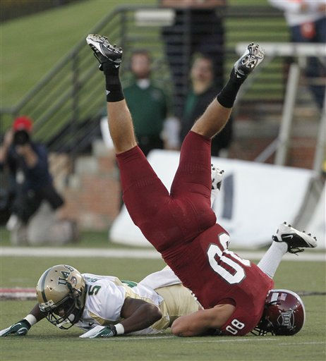 Troy tight end Jim Teknipp &#40;80&#41; is upended by UAB defensive back Jamie Bender &#40;5&#41; in the first quarter of an NCAA college football game at Veterans Memorial Stadium in Troy, Ala., Saturday, Oct. 1, 2011. &#40;AP Photo&#47;Dave Martin&#41; <span class=meta>(AP Photo&#47; Dave Martin)</span>