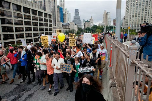 A large group of protesters affiliated with the Occupy Wall Street movement march across the Brooklyn Bridge, effectively shutting parts of it down, Saturday, Oct. 1, 2011 in New York. Police arrested dozens while trying to clear the road and reopen for traffic.&#40;AP Photo&#47;Will Stevens&#41; <span class=meta>(AP Photo&#47; Will Stevens)</span>