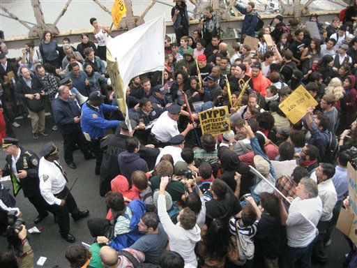 "<div class=""meta image-caption""><div class=""origin-logo origin-image ""><span></span></div><span class=""caption-text"">Police officers enter the crowd to make arrests as a large group of protesters march across the Brooklyn Bridge roadway before being halted by police, Saturday, Oct. 1, 2011, in New York. The demonstrators are affiliated with the Occupy Wall Street group, who have been camping out in New York?s Financial District for the past two weeks. (AP Photo/Daryl Lang) (AP Photo/ Daryl Lang)</span></div>"