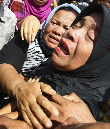 "<div class=""meta ""><span class=""caption-text "">A relative of a plane crash victim cries at a hospital in Medan,  North Sumatra, Indonesia, Sunday, Oct. 2, 2011. The bodies of all 18 people who were on board a plane that crashed into the jungle-covered mountains of western Indonesia were recovered from the wreckage Saturday, an official said.(AP Photo) (AP Photo/ Anonymous)</span></div>"