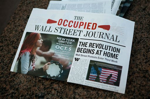 Members of the Occupy Wall Street media organization produced bails of newspapers chronicling the past three weeks of protests under the title &#34;The Occupied Wall Street Journal,&#34; Sunday, Oct. 2, 2011, in New York. Over 700 protestors were arrested on Saturday when they marched on the Brooklyn bridge while protesting against corporate greed and police brutality. &#40;AP Photo&#47;John Minchillo&#41; <span class=meta>(AP Photo&#47; John Minchillo)</span>