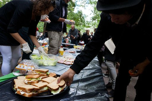 Volunteers prepare donated food for participants of the Occupy Wall Street protest in Manhattan&#39;s financial district&#39;s Zuccotti park, Sunday, Oct. 2, 2011, in New York. The Occupy Wall Street demonstration started out small, with less than a dozen college students, but has grown to include thousands of people in communities across the country. &#40;AP Photo&#47;John Minchillo&#41; <span class=meta>(AP Photo&#47; John Minchillo)</span>