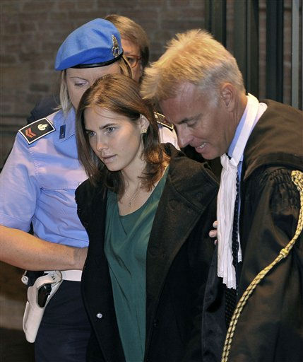 "<div class=""meta ""><span class=""caption-text "">Amanda Knox, accompanied by her lawyer Carlo Dalla Vedova, arrives for an appeal hearing at the Perugia court, central Italy, Monday, Oct. 3, 2011. A tearful Amanda Knox has told an appeals court in Italy that accusations that she killed her British roommate are unfair and groundless. Knox fought back tears as she addressed the court Monday, minutes before the jury went into deliberations to decide whether to uphold her murder conviction. A verdict is expected later in the day.  (AP Photo/Antonio Calanni) (AP Photo/ Antonio Calanni)</span></div>"