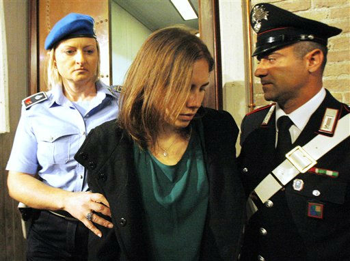 Amanda Knox, center, is escorted as she arrives for an appeal hearing at the Perugia court, central Italy, Monday, Oct. 3, 2011. The 24-year-old Knox looked tense as she entered a packed courthouse. She is expected to address the court in a final plea of her innocence. A verdict is expected later Monday. &#40;AP Photo&#47;Antonio Calanni&#41; <span class=meta>(AP Photo&#47; Antonio Calanni)</span>