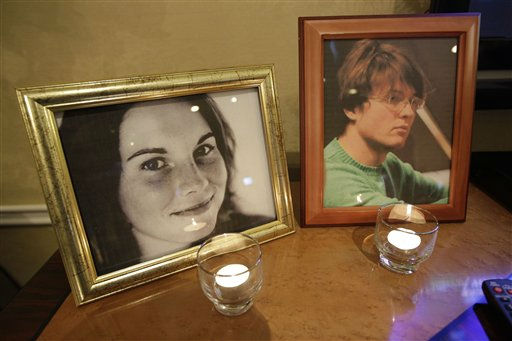 Candles burn in front of photographs of Amanda Knox, left, and her former boyfriend, Raffaele Sollecito, right,  at a private overnight vigil in Seattle, in the early morning hours of Monday, Oct. 3, 2011. Supporters of Knox are awaiting a verdict from an Italian court in the appeal of her conviction in the 2007 death of Knox&#39;s roommate that has garnered international headlines. &#40;AP Photo&#47;Ted S. Warren&#41; <span class=meta>(Photo&#47;Ted S. Warren)</span>