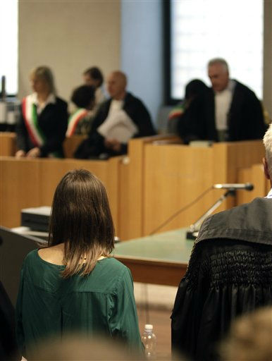 Amanda Knox stands up in front of judge Claudio Pratillo Hellmann, background at right, at the beginning of an appeal hearing at the Perugia court, central Italy, Monday, Oct. 3, 2011. Knox, an American student, was convicted of sexually assaulting and murdering Meredith Kercher, her British roommate in Perugia, and sentenced to 26 years in prison. Knox&#39;s boyfriend at the time of the 2007 murder, Raffaele Sollecito of Italy, was convicted of the same charges and sentenced to 25 years. Both deny wrongdoing and have appealed the December 2009 verdict. &#40;AP Photo&#47;Pier Paolo Cito&#41; <span class=meta>(Photo&#47;Pier Paolo Cito)</span>