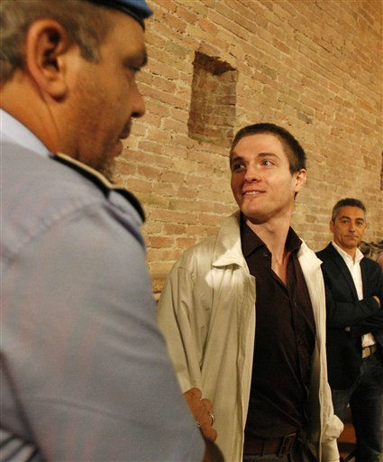Raffaele Sollecito, right, smiles as he arrives in Perugia court, central Italy, Monday, Oct. 3, 2011, to attend an appeal hearing. Knox, an American student, and co-defendant Raffaele Sollecito were convicted of murdering British student Meredith Kercher in 2009. Knox was sentenced to 26 years in prison, Sollecito to 25. &#40;AP Photo&#47;Antonio Calanni&#41; <span class=meta>(Photo&#47;Antonio Calanni)</span>