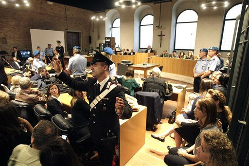 An Italian military police officer asks media representatives to leave the court during the appeal hearing of Amanda Knox and Raffaele Sollecito, at the Perugia court, central Italy, Monday, Oct. 3, 2011. Knox, an American student, and co-defendant Raffaele Sollecito were convicted of murdering British student Meredith Kercher in 2009. Knox was sentenced to 26 years in prison, Sollecito to 25. &#40;AP Photo&#47;Pier Paolo Cito&#41; <span class=meta>(Photo&#47;Pier Paolo Cito)</span>