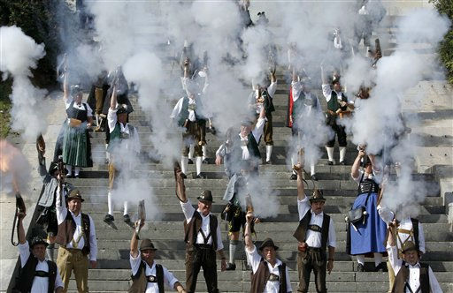 Bavarian riflemen and women in traditional costumes fire their muzzle loaders in front of the &#39;Bavaria&#39; statue in Munich, southern Germany, on Monday, Oct. 3, 2011. Members of various shooting clubs of the region met for a salute on the last day of the famous Oktoberfest beer festival. &#40;AP Photo&#47;Matthias Schrader&#41; <span class=meta>(AP Photo&#47; Matthias Schrader)</span>
