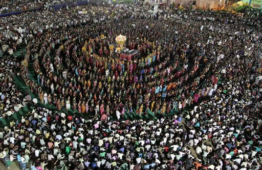 "<div class=""meta ""><span class=""caption-text "">In this Tuesday, Oct. 4, 2011 photo, devotees perform the Garba, a traditional dance of the western Indian state of Gujarat, at the Umiya Mata temple on the eighth night of Navratri, or festival of nine nights, in Surat, about 270 kilometers (169 miles) south of Ahmadabad, India. Umiya Mata is the deity worshipped by Kadwa Patidar Hindus spread across the world. (AP Photo/Ajit Solanki) (AP Photo/ Ajit Solanki)</span></div>"