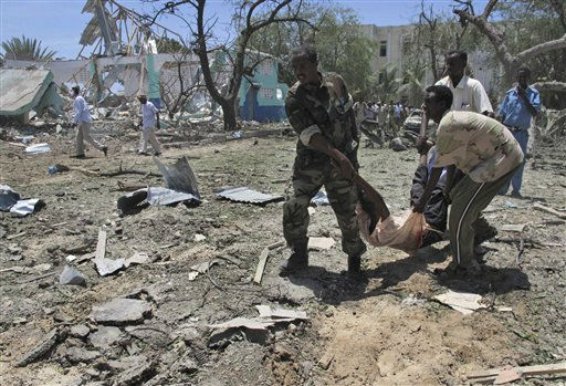 "<div class=""meta ""><span class=""caption-text "">Somalis carry a wounded man at the scene of an explosion in Mogadishu, Somalia, Tuesday, Oct. 4, 2011.  A rescue official says at least 55 people were killed after a car laden with explosives blew up in front of the Ministry of Education in the Somali capital of Mogadishu. The al-Qaida-linked militant group al-Shabab immediately claimed responsibility for the attack on a website it uses, after more than a month of relative calm in Mogadishu.(AP Photo/Mohamed Sheikh Nor) (AP Photo/ Mohamed Sheikh Nor)</span></div>"