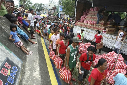 "<div class=""meta ""><span class=""caption-text "">Residents queue up for relief goods being distributed by a non-government organization at Calumpit township, Bulacan province north of Manila, Philippines Tuesday Oct. 4, 2011. Floodwaters slowly receded in many parts of the northern Philippines after two typhoons that killed nearly 60 people, amid appeals for more boats to bring food and water to residents refusing to abandon inundated homes. (AP Photo/Bullit Marquez) (AP Photo/ Bullit Marquez)</span></div>"