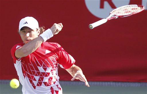 A racket is slipped from the hand of Juan Monaco of Argentina after he returned the ball against Ivan Dodig of Croatia during their first round match of the Japan Open tennis tournament in Tokyo Tuesday, Oct. 4, 2011. &#40;AP Photo&#47;Koji Sasahara&#41; <span class=meta>(AP Photo&#47; Koji Sasahara)</span>