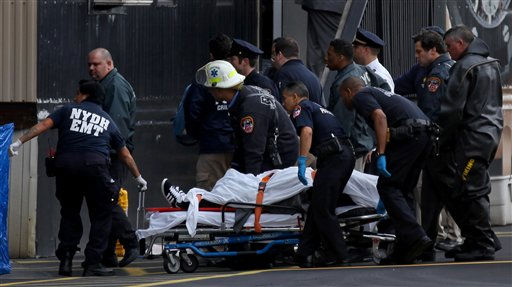 A person who was pulled from the East River after a helicopter crashed into the water is wheeled away Tuesday, Oct. 4, 2011 in New York. The person was onboard the craft with four others as it crashed into the East River after taking off from a launch pad on the riverbank, killing one and seriously injuring at least two others. &#40;AP Photo&#47;Craig Ruttle&#41; <span class=meta>(AP Photo&#47; Craig Ruttle)</span>