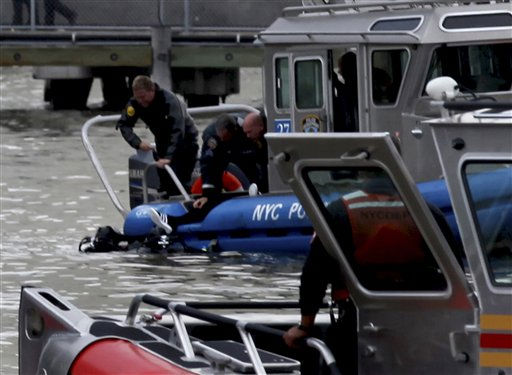 A person is pulled from the East River in New York Tuesday, Oct. 4, 2011 by rescue personal after a helicopter with five people aboard crashed into the river after taking off from a launch pad on the riverbank, killing one and seriously injuring at least two others.  &#40;AP Photo&#47;Craig Ruttle&#41; <span class=meta>(AP Photo&#47; Craig Ruttle)</span>