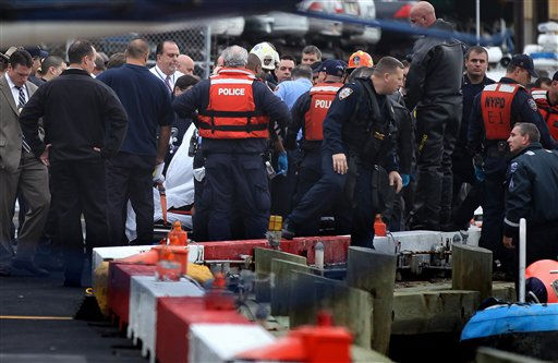 A person who was pulled from the East River after a helicopter crashed into the water is secured on a stretcher Tuesday, Oct. 4, 2011 in New York. The person and four others were on board the a Bell 206 helicopter as it crashed into the East River after taking off from a launch pad on the riverbank, killing one and seriously injuring at least two others. &#40;AP Photo&#47;Craig Ruttle&#41; <span class=meta>(AP Photo&#47; Craig Ruttle)</span>