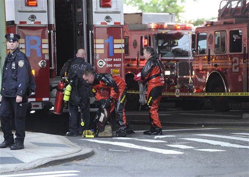 "<div class=""meta ""><span class=""caption-text "">Divers unload gear near the scene of a helicopter crash in the East River, Tuesday, Oct. 4, 2011, in New York. A helicopter with five people aboard crashed into the East River on Tuesday afternoon after taking off from a launch pad on the riverbank, killing one and seriously injuring at least two others. (AP Photo/ Louis Lanzano) (AP Photo/ Louis Lanzano)</span></div>"
