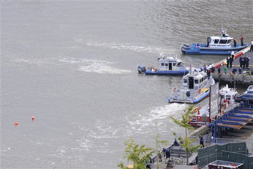 Two orange buoys mark the area where a helicopter with five people aboard crashed into the East River on Tuesday afternoon, Oct. 4, 2011, after taking off from a launch pad on the riverbank, killing one passenger and injuring the others. &#40;AP Photo&#47; Louis Lanzano&#41; <span class=meta>(AP Photo&#47; Louis Lanzano)</span>
