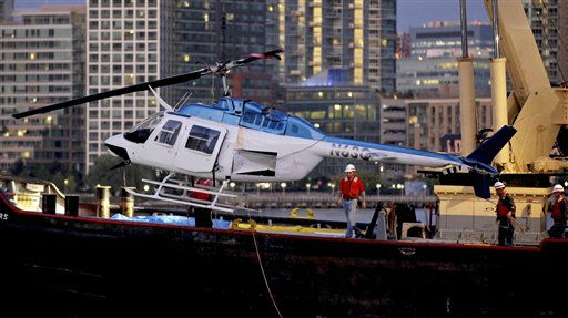 A helicopter that crashed into the East River in New York is hoisted from the water Tuesday, Oct. 4, 2011. The helicopter with five people aboard crashed into the river Tuesday afternoon after taking off from a launch pad on the riverbank, killing one passenger and injuring three others. &#40;AP Photo&#47;Craig Ruttle&#41; <span class=meta>(AP Photo&#47; Craig Ruttle)</span>