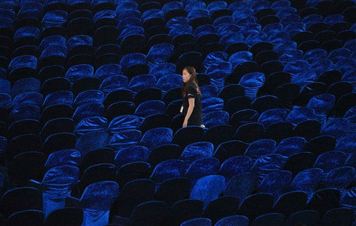 "<div class=""meta image-caption""><div class=""origin-logo origin-image ""><span></span></div><span class=""caption-text"">A worker arranges chairs for the opening ceremony of the Busan International Film Festival at Busan Cinema Center in Busan, South Korea, Wednesday, Oct. 5, 2011. The cinema center will serve as the primary permanent venue of the annual film festival, one of Asia's largest film festivals. This year's festival is scheduled for Oct. 6-14. (AP Photo/Ahn Young-joon) (AP Photo/ Ahn Young-joon)</span></div>"