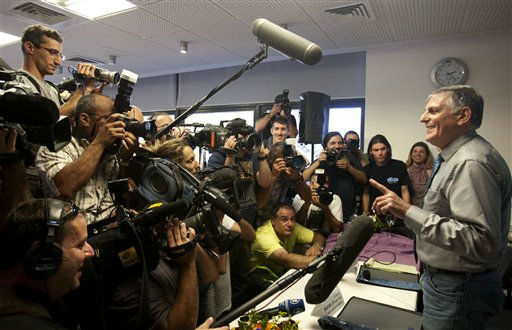 "<div class=""meta ""><span class=""caption-text "">Israeli scientist Daniel Shechtman, right, addresses the media during a news conference at the Haifa Technion, Israel, Wednesday, Oct. 5, 2011. Shechtman won the 2011 Nobel Prize in chemistry on Wednesday for his discovery of quasicrystals, a mosaic-like chemical structure that researchers previously thought was impossible. (AP Photo/Ariel Schalit) (AP Photo/ Ariel Schalit)</span></div>"